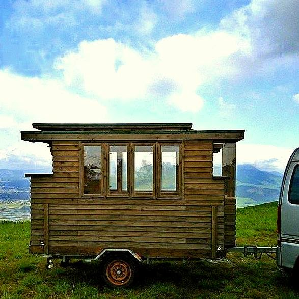The flying tortoise the simple beauty of this tiny for Minimalist house on wheels