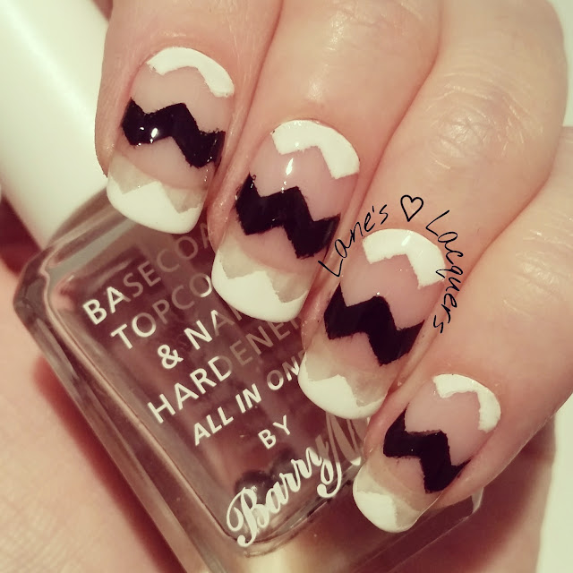 40-great-nail-art-ideas-black-and-white-chevron-negative-space-manicure (2)