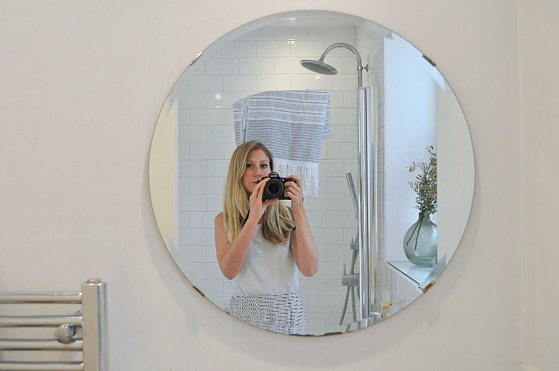 Large bathroom mirror reflects light