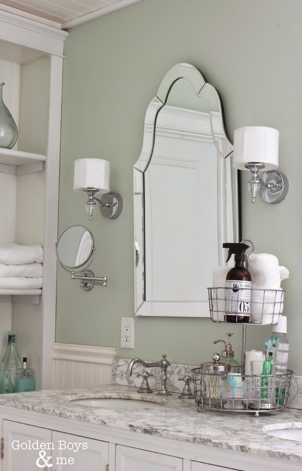 Lowes venetian arch mirror with home depot waterton sconces in master bathroom