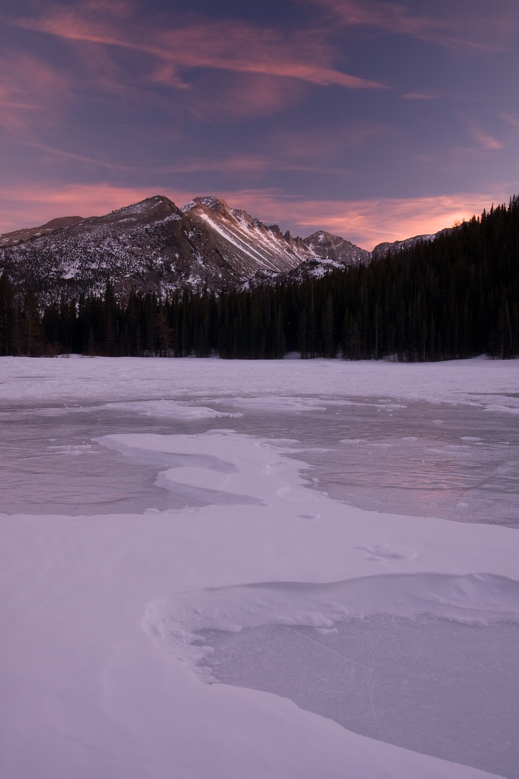 longs peak and frozen bear lake at sunset