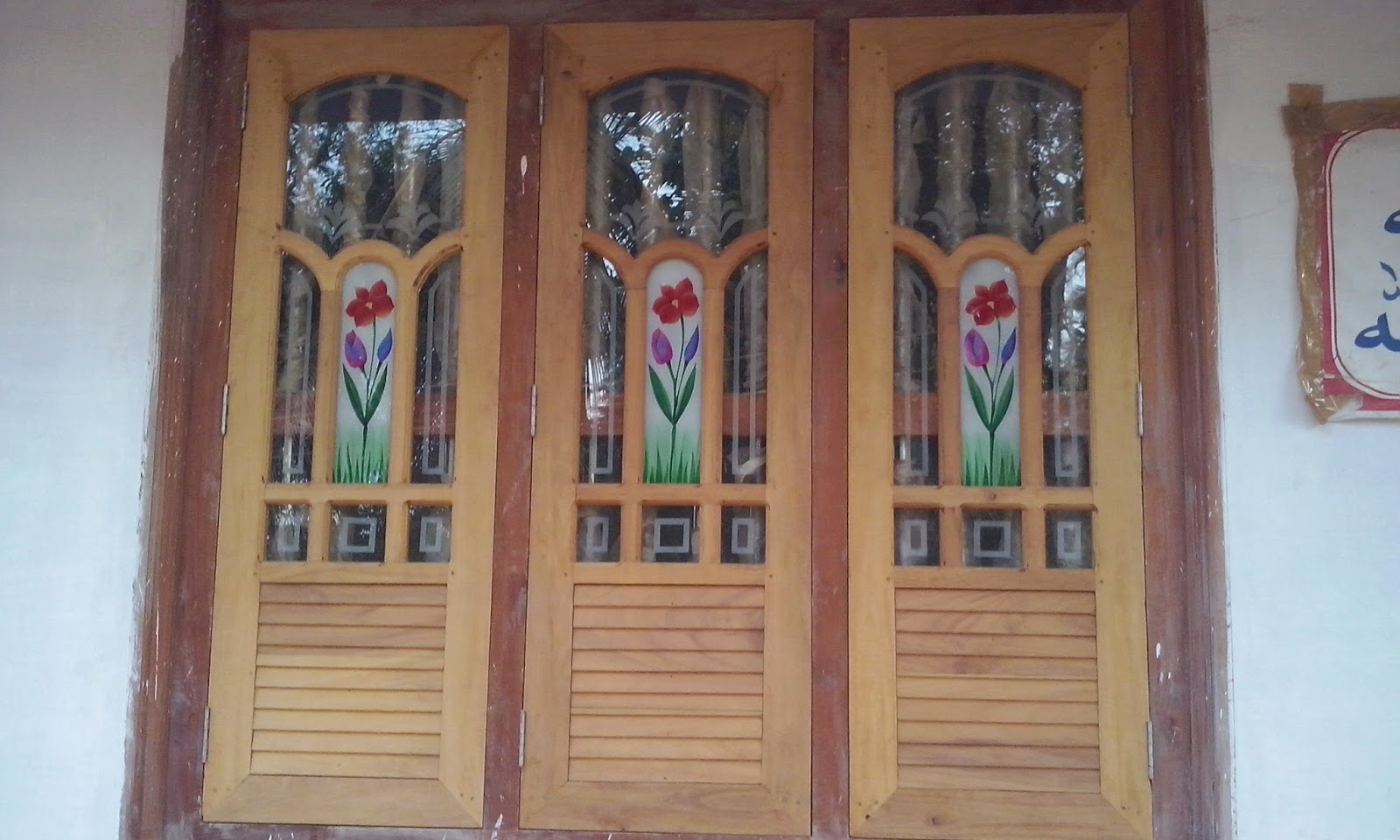 Kerala style carpenter works and designs february 2015 for Wooden window design with glass