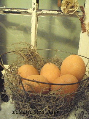Eclectic Red Barn: Old wire basket with terracotta eggs