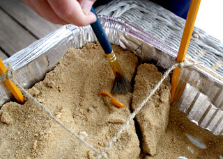 Tessa enjoyed brushing away sand from the artifacts...even more than digging, I think.