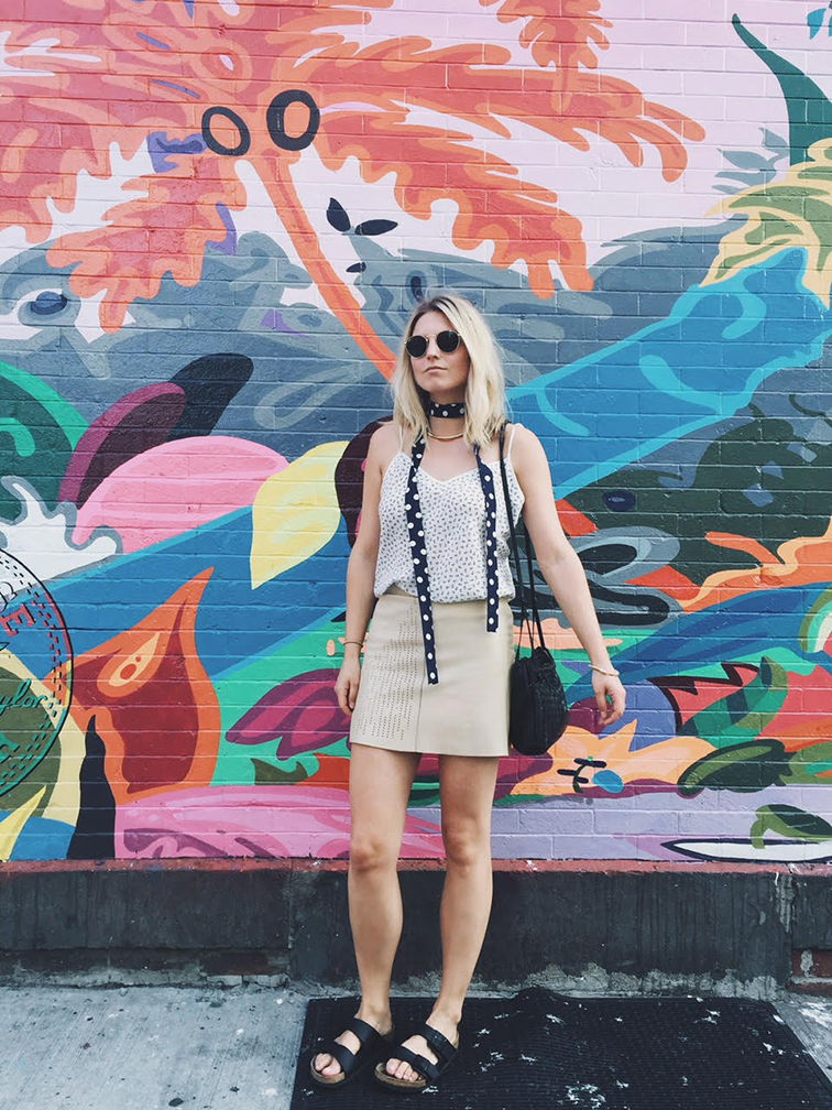 Leather mini skirt, black Arizona Birkenstocks, polka dot neck scarf, Brooklyn, street art