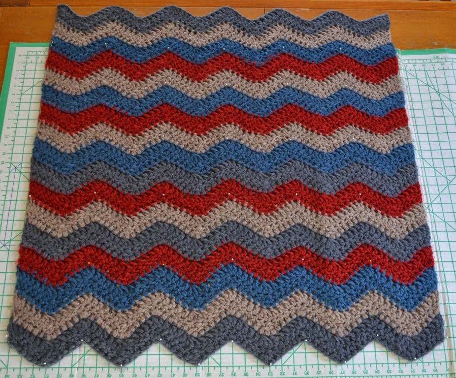 Ripple blanket pinned onto blocking board.