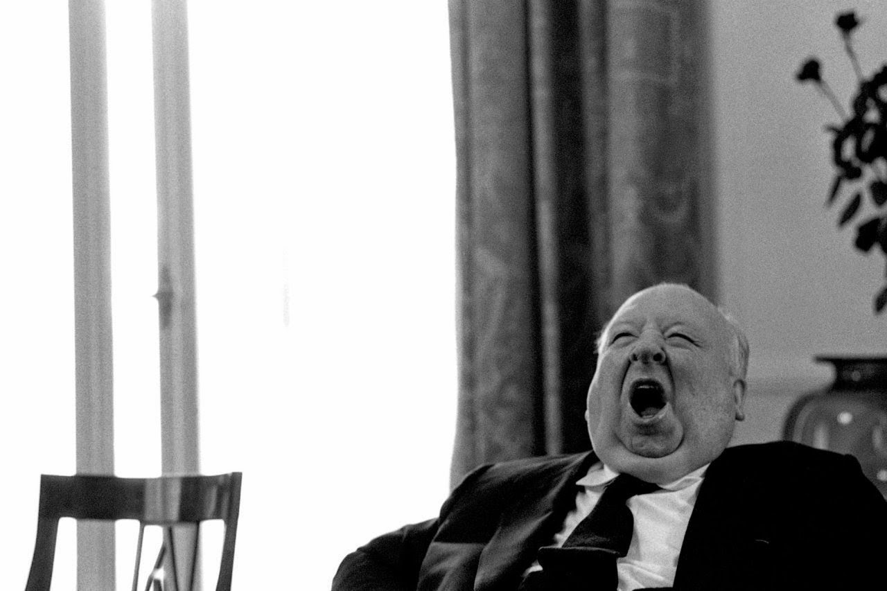 Alfred Hitchcock getting sleepy at home.
