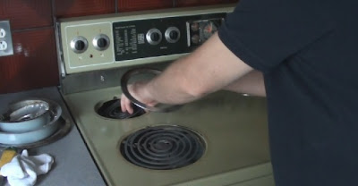 Stripping down a stove for paint