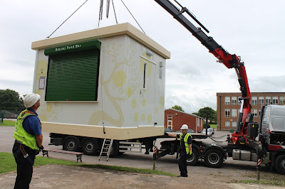 Food Cube being craned into position