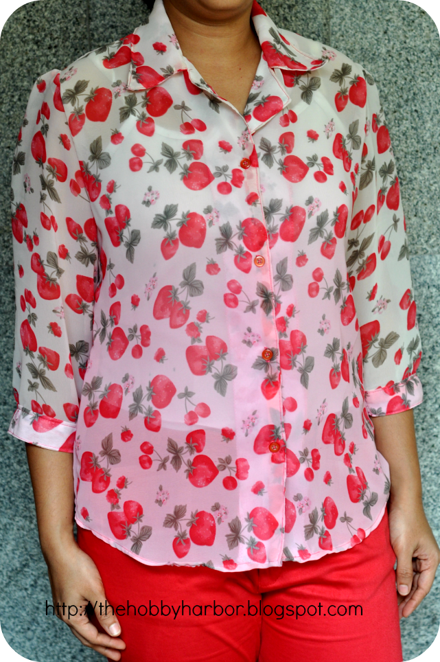 sheer fabric blouse or shirt for women made with strawberry fruit print with notched collar. convertible collar. button down shirt