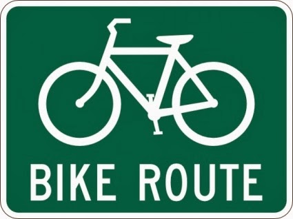 """Bike Route"" roadway sign depicting a white bicycle against green background"