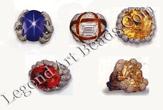 An assortment of Verdura's distinctive cocktail rings: a large star sapphire set in a pave diamond mount; an emerald cut diamond in a wrapped enamel mount with pave diamonds; a golden sapphire and pave diamonds; a large yellow diamond in a pave diamond turban mount; a spinet and pave diamonds, all C. 1955-1965.
