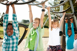 Kids playing on monkey bars