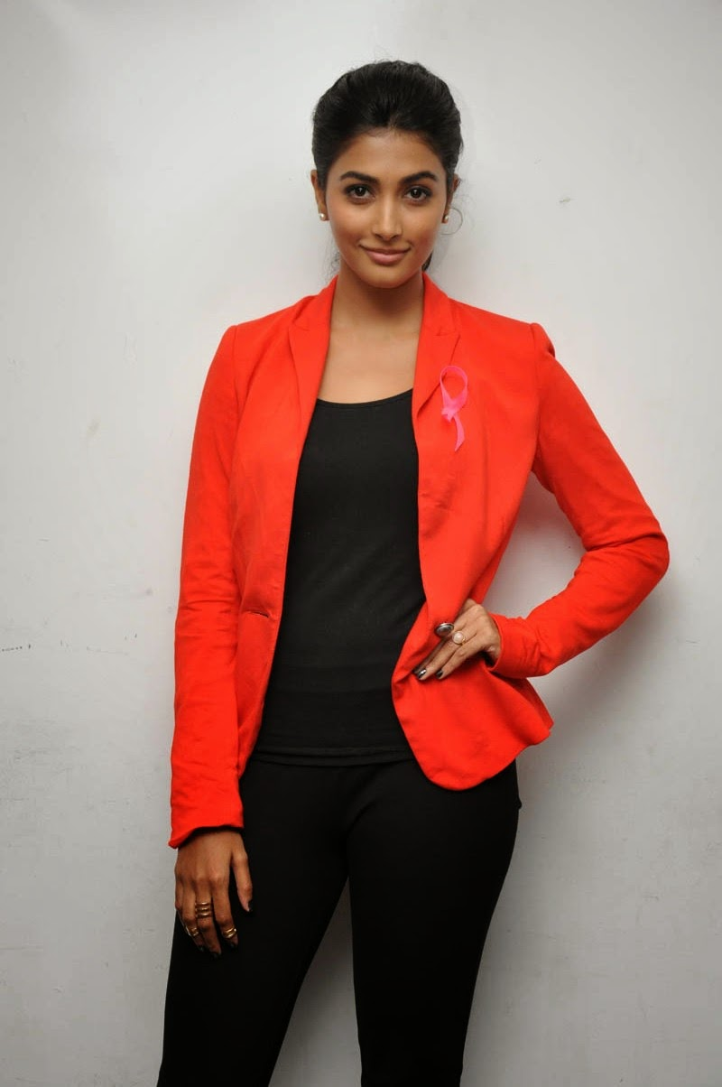 Pooja Hegde in Black Tight T-Shirt and Leggings and Orange Coat Sizzling Pics