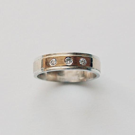 https://www.etsy.com/nz/listing/103770689/18-k-gold-silver-and-3-diamond-wedding