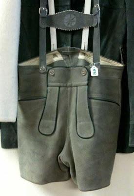 Gray suede lederhosen hanging on a hanger
