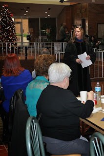Dr. Holly Miller makes a presentation to CJ graduates and their friends and families at a pre-Commencement reception.