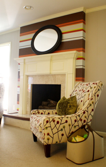 Traditional fireplace painted with modern horizontal stripes in varying widths and earth tone colors, from Kristen F. Davis Designs