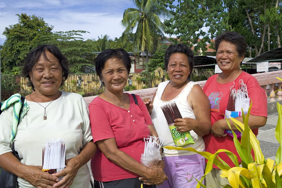 Filipina Women Selling Candles