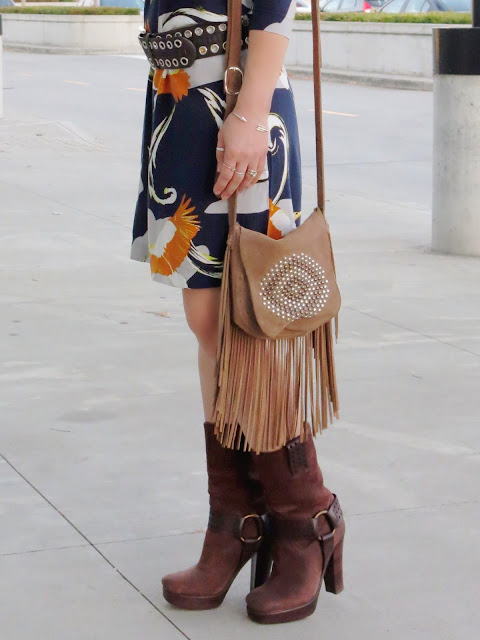 styling a stork-print shift dress with a wide belt, Frye platform booties, and a fringy bag