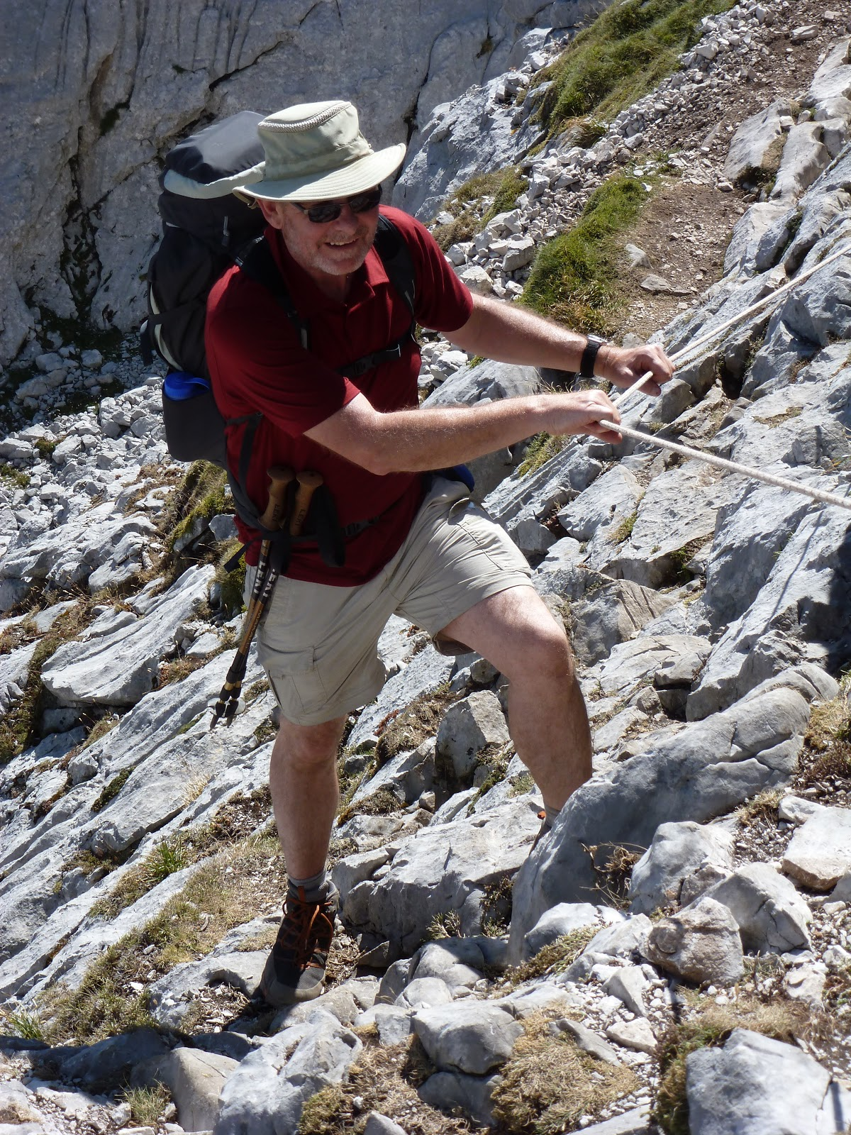 David using rope on steep rocks