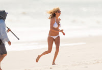 Kate Upton running in a bikini at the beach