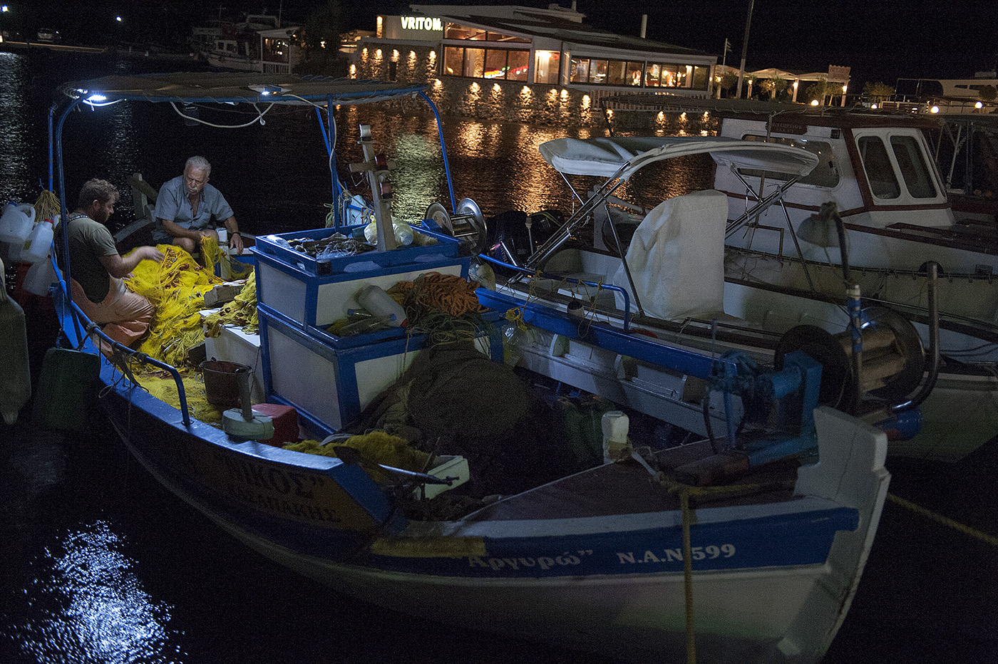 Fishermen at night in Elounda, Crete, Greece