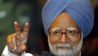 Manmohan Singh: Prime Minister of India showing two fingers symbol of peace to crowd fans