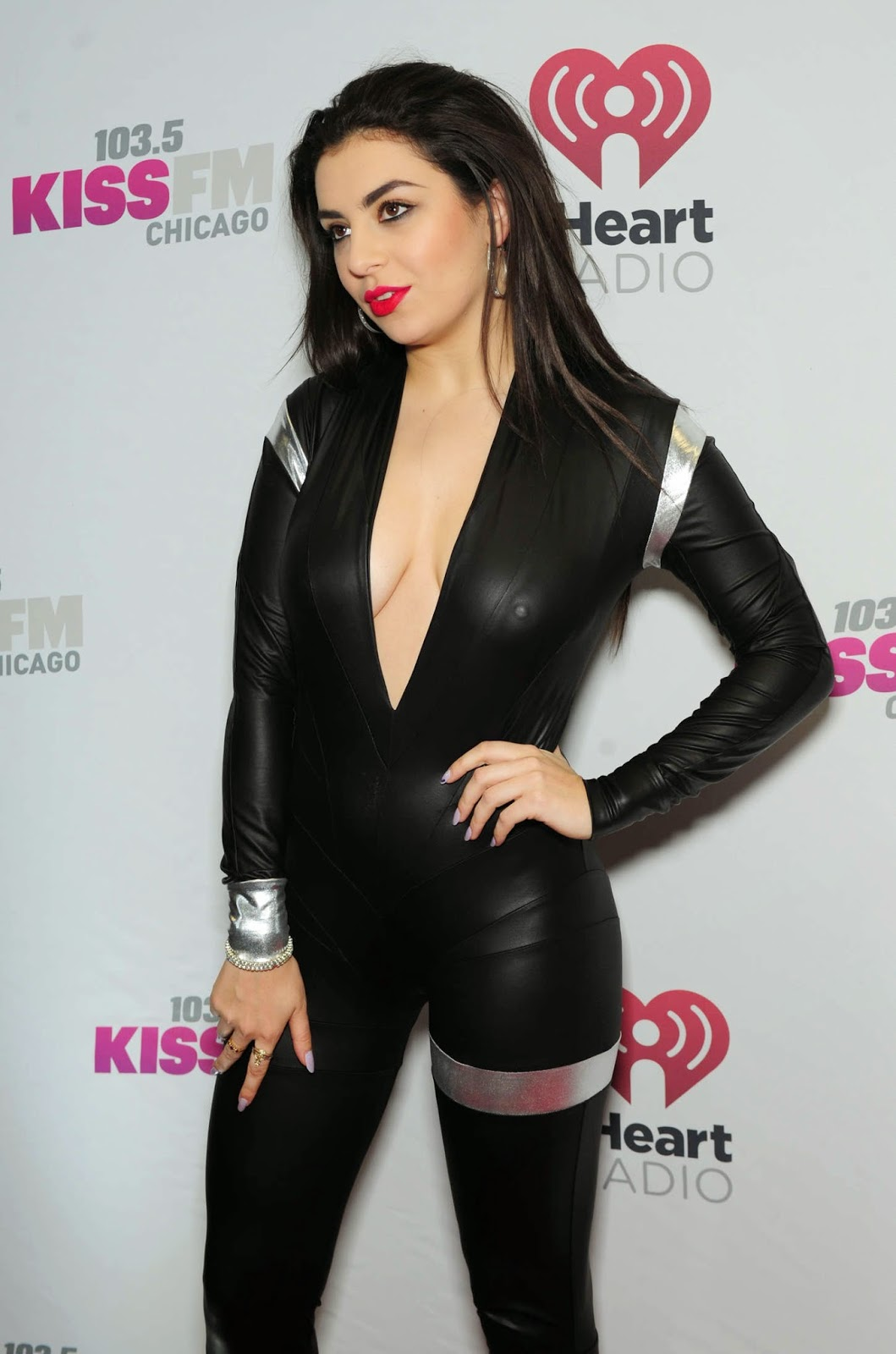 Charli XCX goes braless in a latex jumpsuit at the 103.5 KIIS FM Jingle Ball