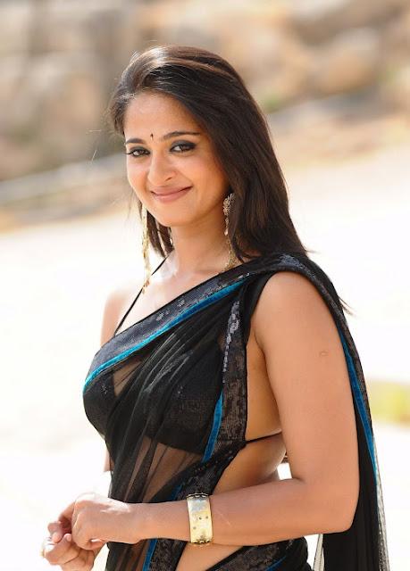 Anushka Shetty Spicy Stills In Black Saree 8