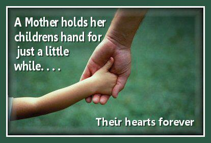 A mother holds her children's hand for just a little while....