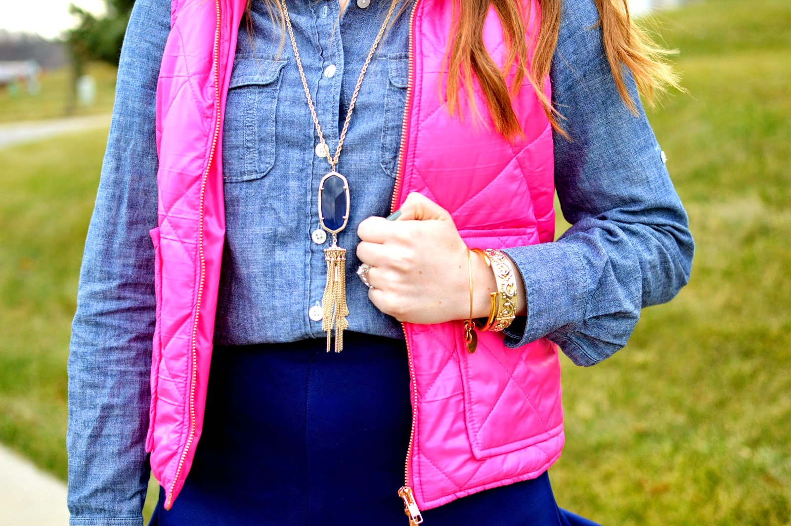 pink puffer vest a chambray blouse and a navy skirt from www.amemoryofus.com