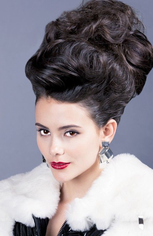 Lily Collins Bouffant Hairstyle for Short Hair Lily Collins bouffant is the best look to try if you are looking for something retro and sleek. For achieving the look, tie your hair in a ponytail and backcomb underneath for adding more volume.