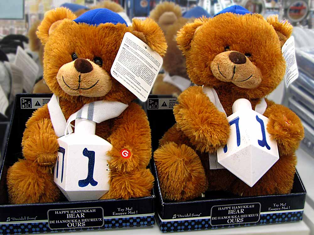 two cute stuffed brown bears with dreidels to celebrate Hannukah