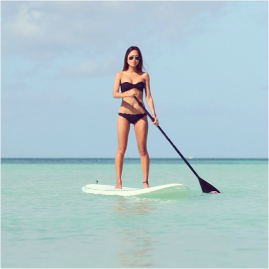 Blogger Aimee Song in Marysia Swim Paddleboarding
