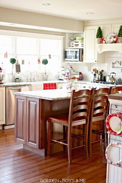 Kitchen with white cabinets, cherry island, white subway tile at Christmas-www.goldenboysandme.com