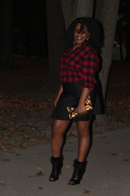 A-fall-fashion-staple-the-ever-popular-red-and-black-flannel-styled-with-girly-basics-like-a-black-flirty-skirt-vintage-silver-chain-necklace-and-fur-trimmed-open-toe-booties