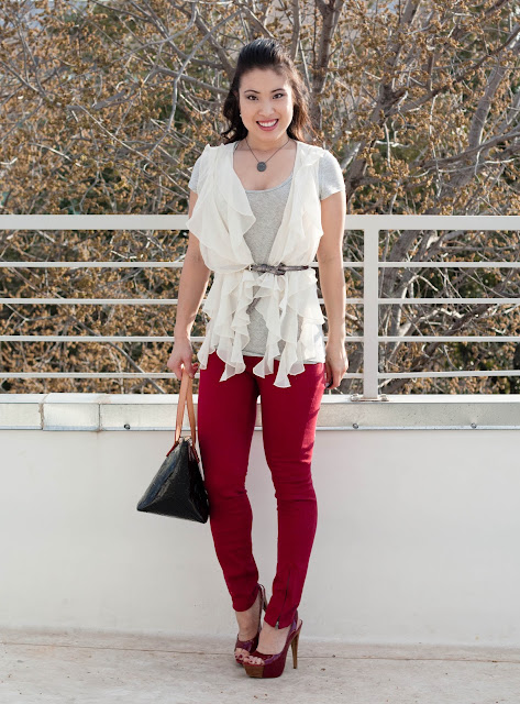 red pants ruffle vest