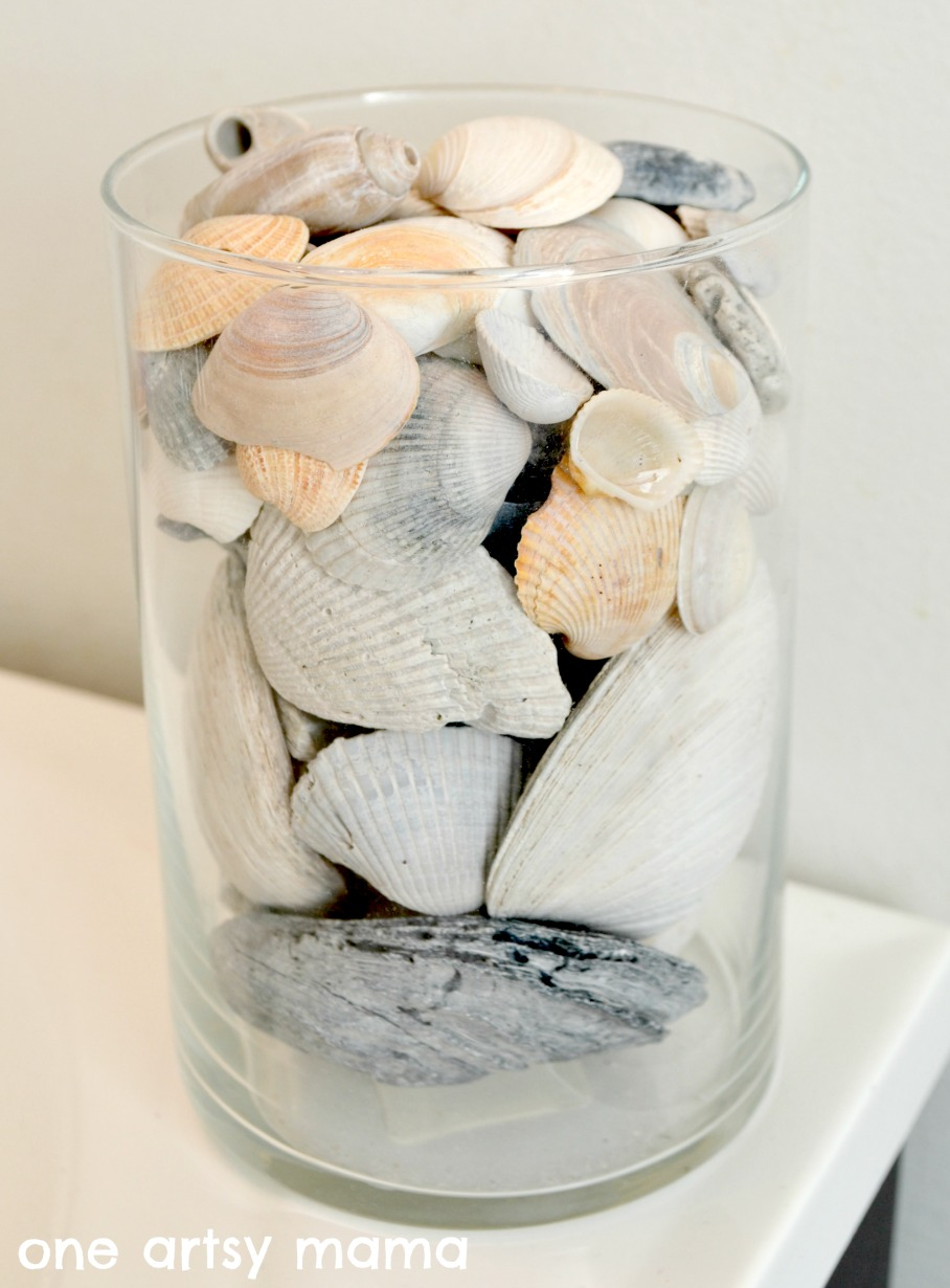 Beach in a basket using the seashells you found amy latta creations i started by choosing my largest shells that were in good condition and placing them around the edges of the vase at the bottom reviewsmspy
