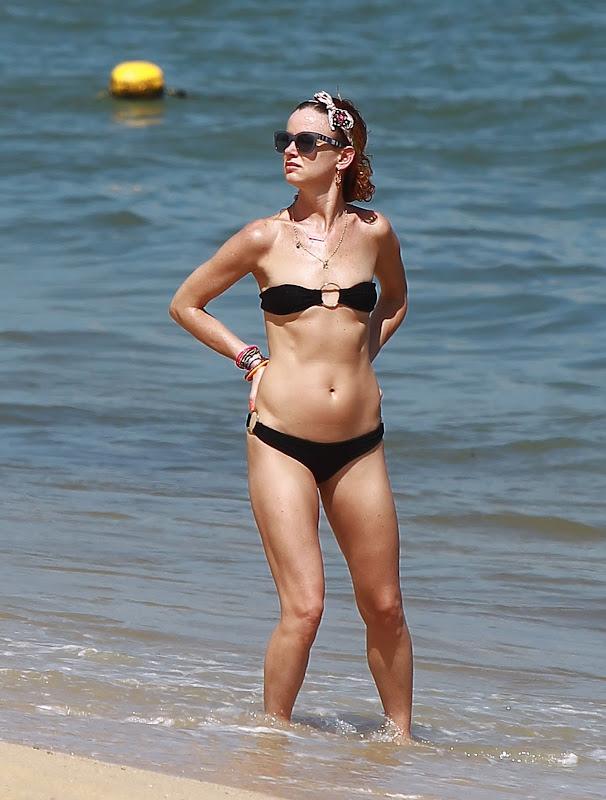 Juliette Lewis wearing a black  Bikini on the beach in Mexico