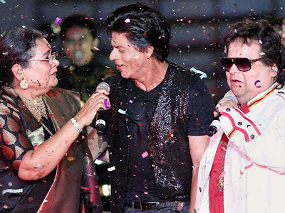 Shah Rukh Khan Bappi lahri performs during the ipl ceremony