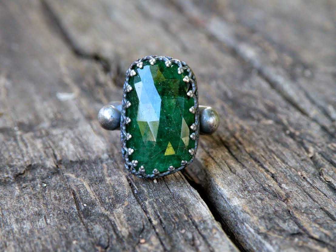 http://www.meshedesigns.com/collections/gemstone-rings/products/emerald-rose-cut-ring