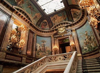 The grand staircase of Palacio de Linares, home of Case de America in Madrid, Spain