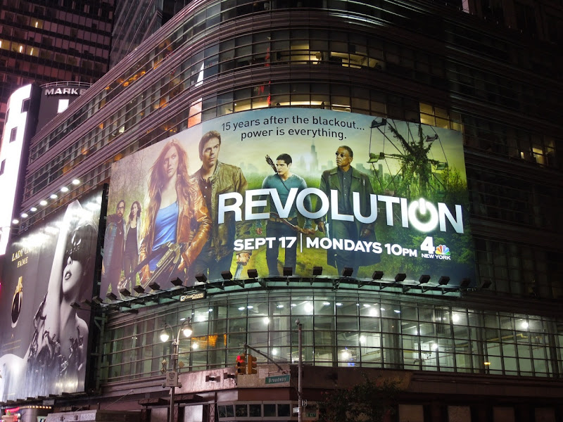 Revolution billboard Times Square night