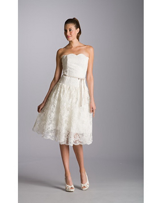 8th archetypal is Knee breadth strapless bells dress featuring a scalloped