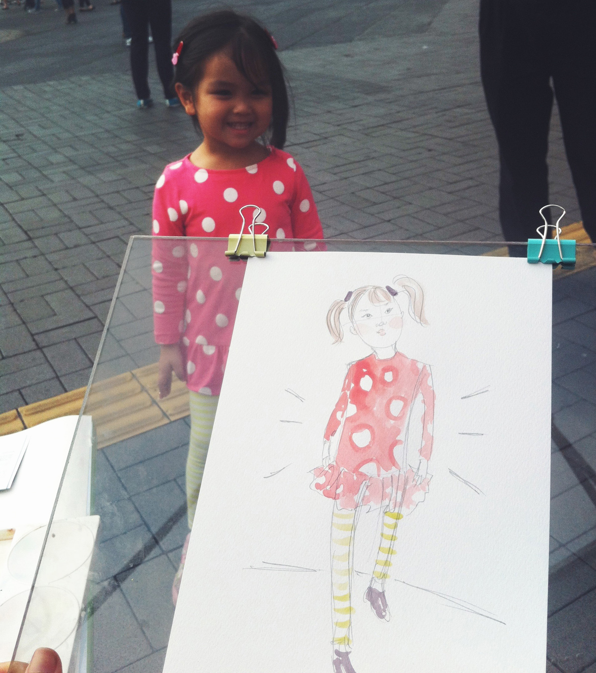 Kitty N. Wong / Live sketch in Hong Kong of little girl in pink polkadots