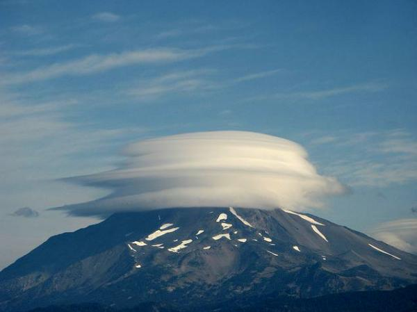 Lenticular cloud caps this mountain in Oregon.