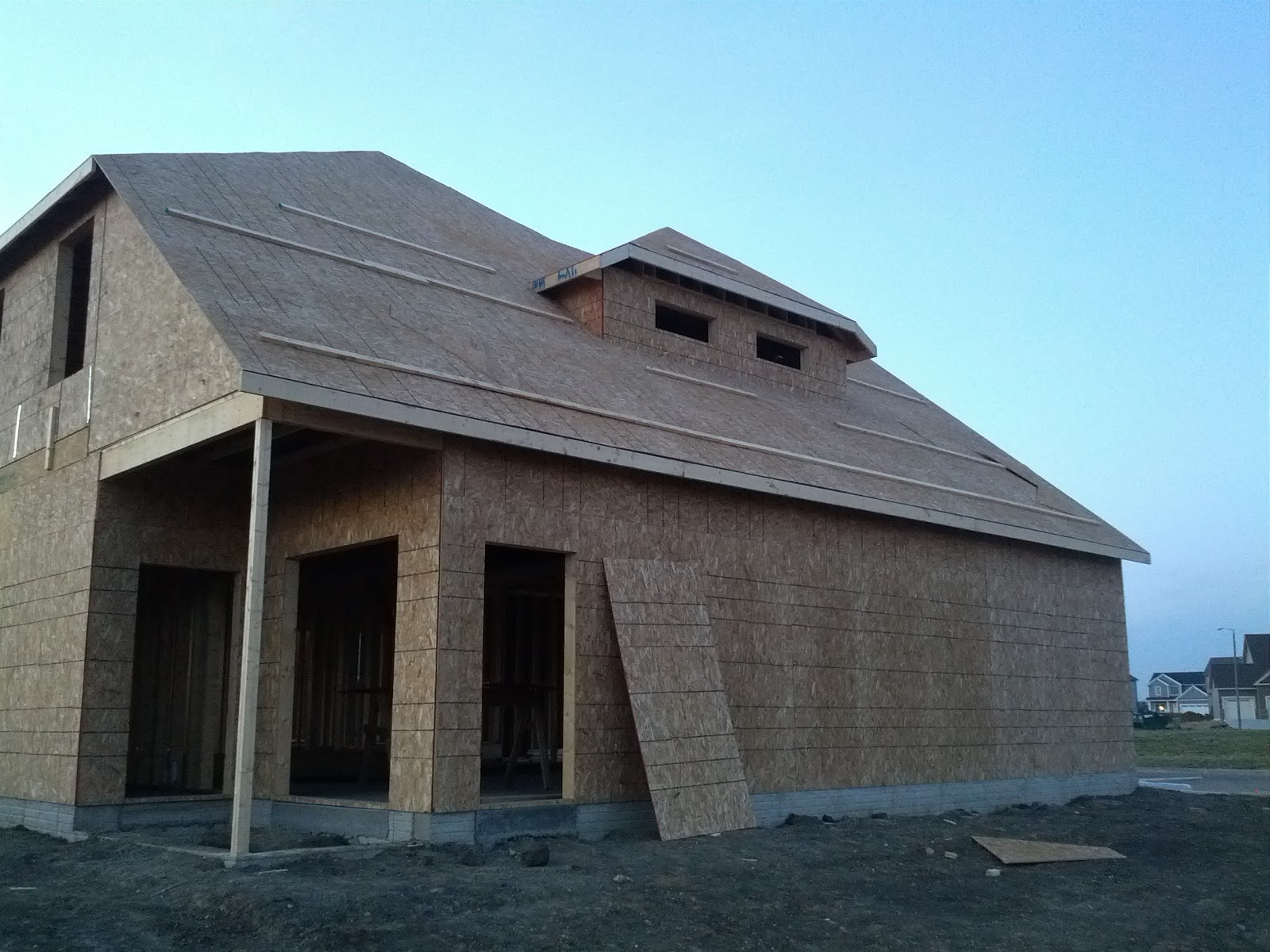 The building of greuel manor sheeting on the roof for Garage overhang