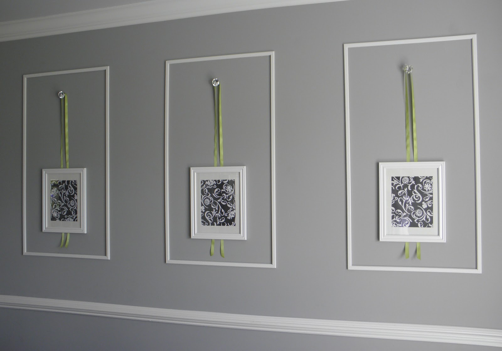 i purchased unfinished trim pieces and cut them to make large wall frames each piece was