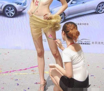 body painting at chinese auto shows raises eyebrows 2014 body painting